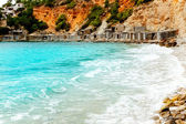 Cala d Hort Ibiza beach with traditional wood mooring — Stock Photo