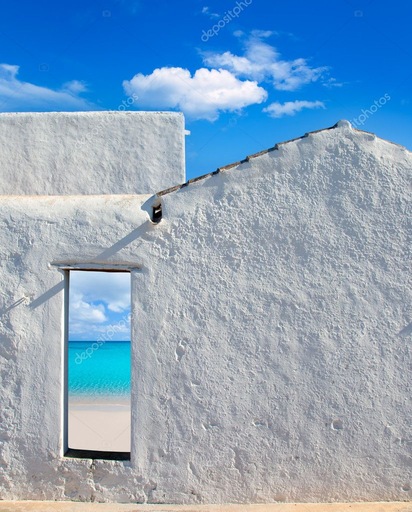 Balearic islands idyllic turquoise beach view through whitewashed house open door — Stock Photo #11350534