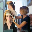 Backstage hairdressing fashion with make-up artist - Stock Photo