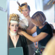 Foto Stock: Backstage hairdressing fashion with make-up artist