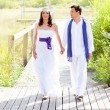 Couple happy in wedding day walking outdoor - Stock Photo