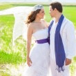 Couple in wedding day with wind on veil — Stock Photo #11907683