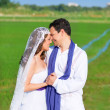 Couple in wedding day hug in green meadow — Stock Photo