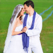 Stock Photo: Couple in wedding day hug in green meadow