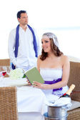 Couple in wedding day woman reading book on banquet — Stock Photo