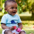 Little african american baby boy playing in the grass — Stock Photo #10967915