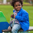 Royalty-Free Stock Photo: Outdoor portrait of a black baby  playing at playground