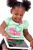 Little african american girl using a tablet pc — Stok fotoğraf