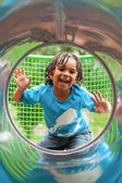 Portrait of a cute african little boy at playground — Stock Photo