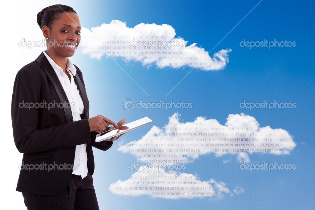 Smiling african american businesswoman using a tactile tablet, isolated on white background — Stock Photo #12275054
