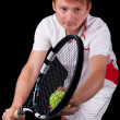 Portrait of a young male tennis player about to serve the ball — Stock Photo