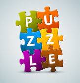 Napis kolorowe puzzle wektor — Wektor stockowy