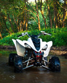 ATV in water — Stock Photo