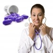 Young female doctor with pills in the background — Stock Photo #11005468