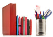 Stationery and books on white background — Stock Photo