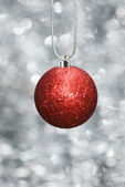 Christmas ball with festive background — Stock Photo