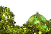 Green christmas decorations on white — Stock Photo