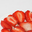 White dish with sliced ripe fresh strawberries — Stockfoto