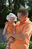 Portrait of father and young blond daughter in panama — Stock Photo