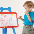 Little cute boy drew a family on whiteboard — Stock Photo