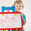 Little smiling cute boy shows his family painted on whiteboard — Stock Photo