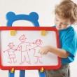 Little cute boy shows his family painted on whiteboard — Photo