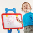Little smiling boy drew a sun on the whiteboard — Photo