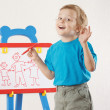 Little smiling cute blond boy drew a family on a whiteboard — Stock Photo