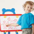 Little smiling boy shows his family painted on a whiteboard — Stock Photo