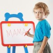 Little cute boy wrote the word mama on a whiteboard — Stock fotografie