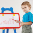 Little serious boy drew diagram of the growth on the whiteboard — Stock Photo #11469442