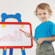 Little cute smiling boy drew diagram of the growth on the whiteboard — Foto de Stock