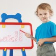 Little cute smiling boy drew diagram of the growth on the whiteboard — Stock fotografie