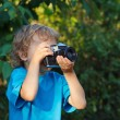 Young cute photographer with a camera — Stock Photo
