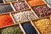 Peas, beans and lentils in the wooden box — Stock Photo