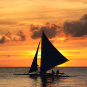 Sailboat in sunset. — Stock Photo