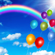 Colorful balloons on the blue sky background — Stock Photo
