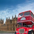 Red double-decker for Parliament — Stock Photo