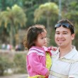 Stock Photo: Father and daughter in park