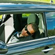 Man sleeps in a car — Stock Photo #11412763
