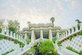 Pavilion decorated with mosaic in Park Guell starting the sunset — Stock Photo