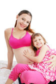 Beautiful pregnant woman with her daughter — Stock Photo