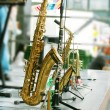 Golden saxophone alto on stage — ストック写真