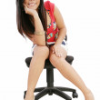 Gorgeous young woman sitting on a chair isolated over white back — Stock Photo