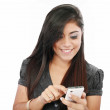 Portrait of a happy young business woman texting from her cellph — Stock Photo