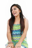 Happy woman laughing against white background — Stock Photo
