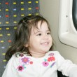 Cute little girl looking window inside a moving train — Stock Photo