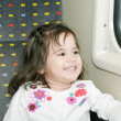 Stock Photo: Cute little girl looking window inside a moving train