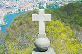 View of Lugano from San Salvatore mountain with a cross in front — Stock Photo
