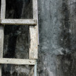 Stock Photo: Wooden ladder leaning against the wall